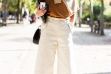 12 grey heels, a mustard top, a beige sweater, creamy culottes for a bright touch