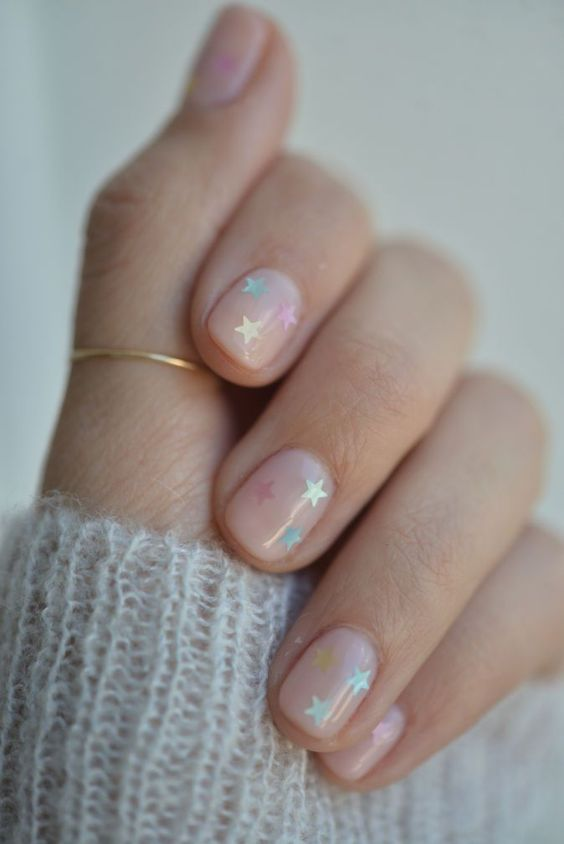 nude nails with colorful stars is a great and easy idea of a nail art