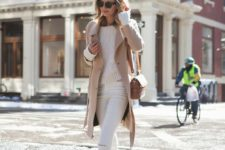 12 white ripped jeans, a white sweater, a camel trench, printed booties