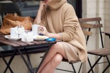 13 a camel sweater and skirt, a brown hat and white sneakers for a relaxed look