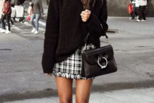 13 a casual look with a black sweater, a tweed mini skirt, white sneakers and a black bag