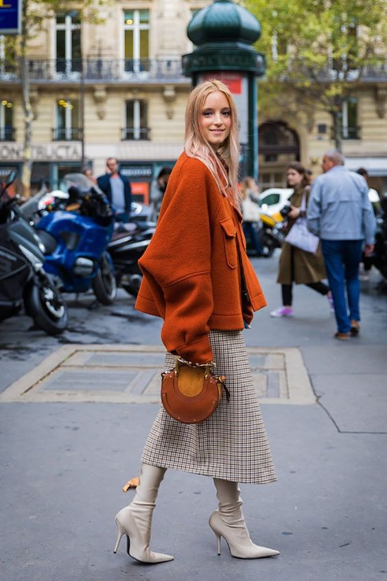 a checked wrap midi skirt, a rust oversized coat and a matching bag, cremay sock boots