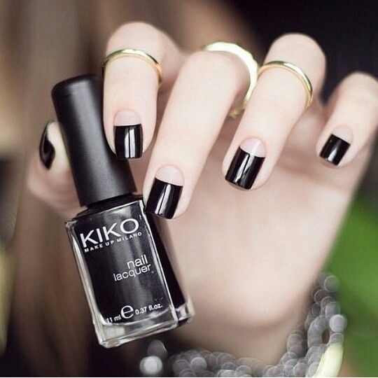 a gothic take on a French manicure with a large black tip