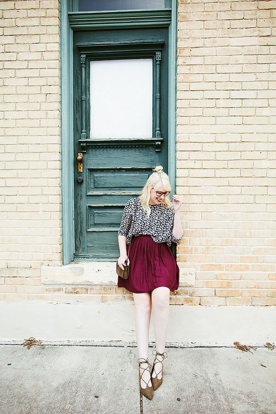 a printed blouse in black and white, a plum skirt, earthy strappy flats