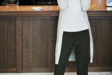 13 a white t-shirt, an off-white cardigan, olive green pans and nude shoes