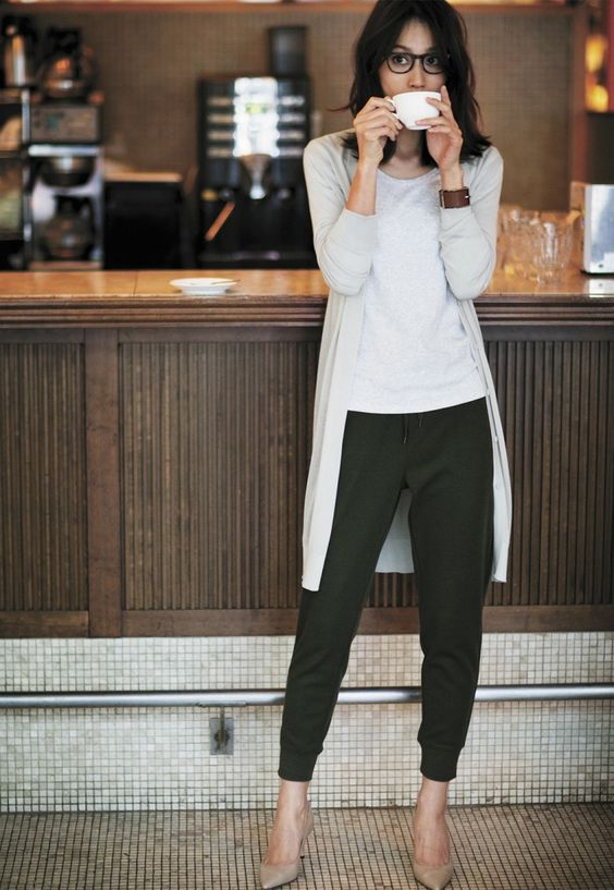 a white t-shirt, an off-white cardigan, olive green pans and nude shoes
