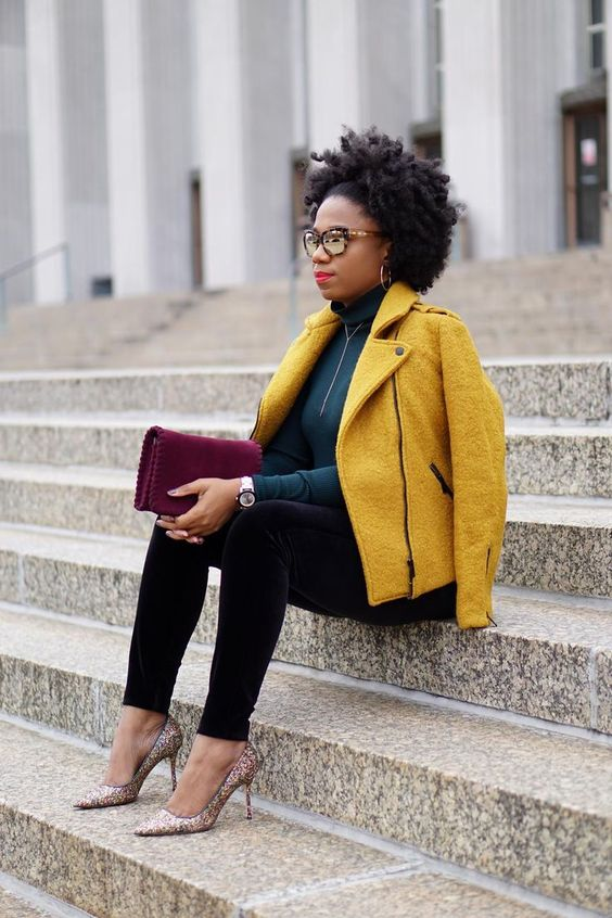 black velvet pants, a dark green turtleneck, printed shoes and a mustard jacket