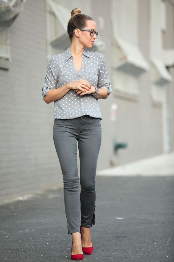 grey pants, a grey polka dot shirt, red shoes for a touch of color in the outfit