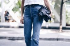 13 high waisted blue jeans with a raw hem, white top and brown boots for the fall