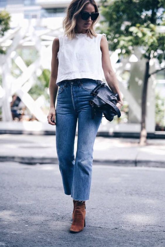 high waisted blue jeans with a raw hem, white top and brown boots for the fall