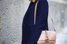 14 a bold blue coat and beanie, a blush bag and black denim