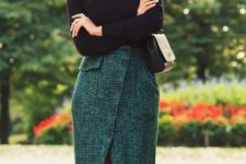 14 a chic look with a black turtleneck and an emerald tweed midi skirt on buttons