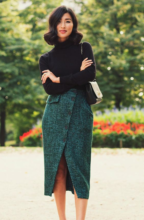 a chic look with a black turtleneck and an emerald tweed midi skirt on buttons