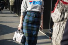 14 a gorgeous look with a checked midi pencil skirt, a grey logo sweatshirt, blue shoes and a grey bag