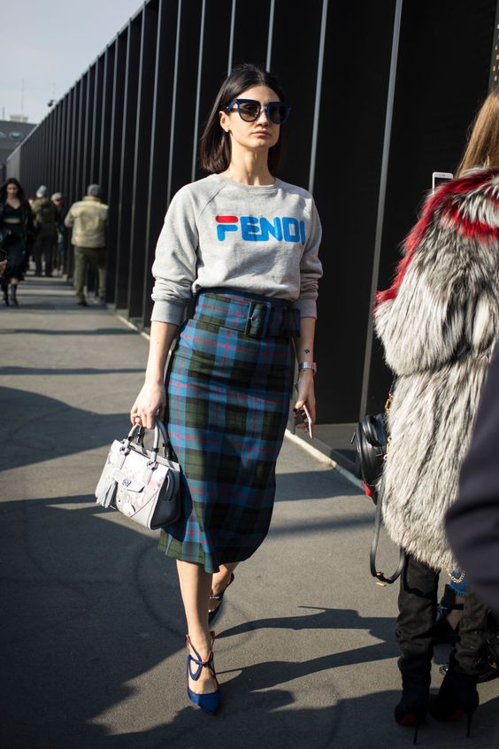 a gorgeous look with a checked midi pencil skirt, a grey logo sweatshirt, blue shoes and a grey bag