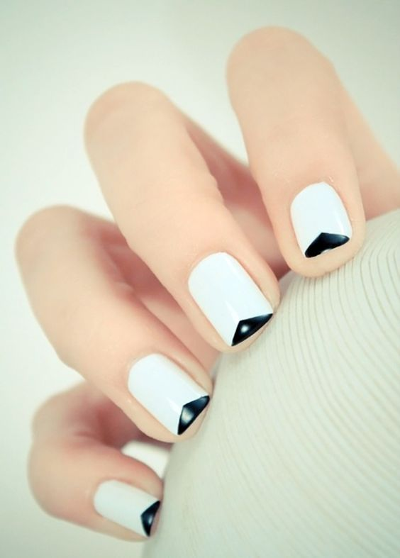 a minimalist geometric black and white take on French nails