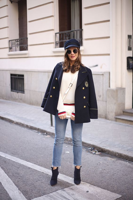 a navy inspired look with blue raw hem jeans, navy booties and a navy jacket