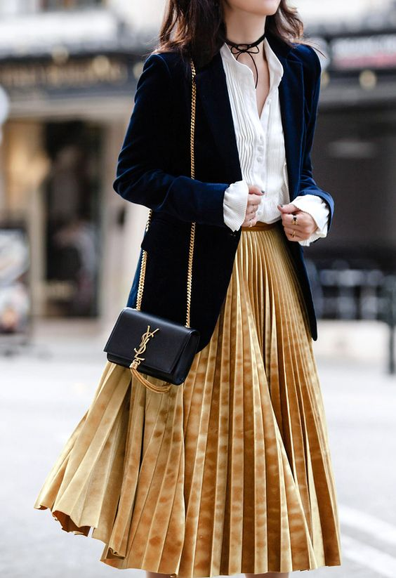 a velvet fall look with a white shirt, a navy velvet blazer, a mustard pleated midi skirt