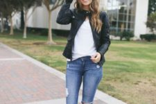 14 a white t-shirt, ripped blue jeans, a black leather jacket, tan mules