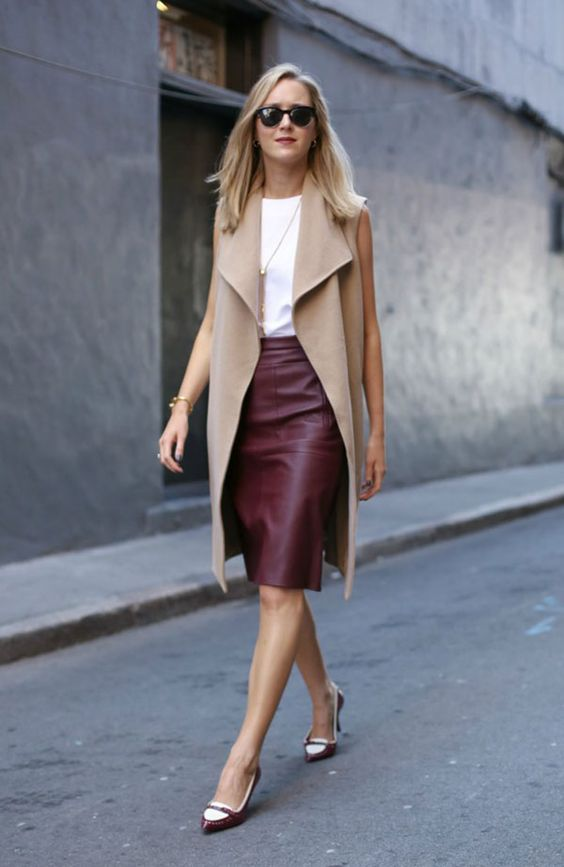 a white top, a tan long vest, a burgundy knee skirt, burgundy heels for the fall