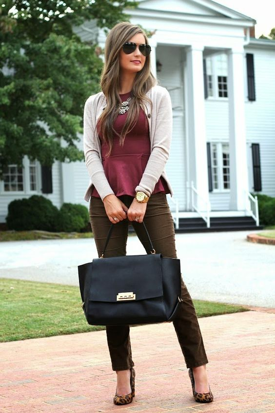 brown pants, a plum-colored peplum top, a neutral cardigan, leopard print shoes and a black bag