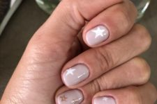 14 nude nails with white and copper glitter stars for a bright touch