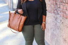 14 olive green jeans, a black top, a black jacket, brown booties and a bag for a casual work look
