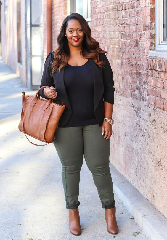 olive green jeans, a black top, a black jacket, brown booties and a bag for a casual work look