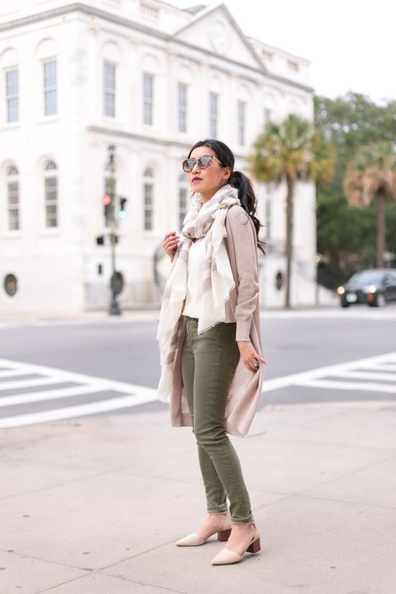 olive green jeans, a neutral sweater, a scarf and neutral comfy heels