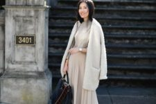 15 a grey top, an off-white pleated midi, an off-white fluffy cardigan, blush shoes and a bag