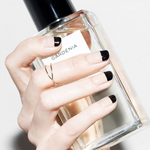 a nude and black French manicure with a large tip for a geometric touch