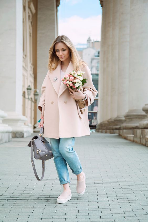 a pastel look with a white tee, cuffed jeans, blush slipons, a blush oversized coat