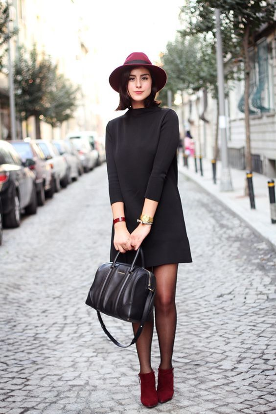 a turtleneck mini dress with long sleeves, a burgundy hat and red booties plus a black bag