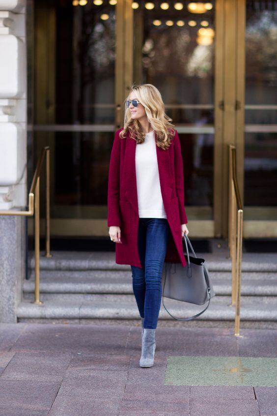 a white tee, blue denim and a bold burgundy coat to embrace the fall