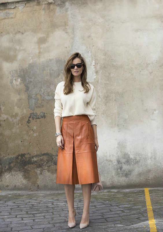an amber knee skirt, a creamy sweater and nude shoes for the fall