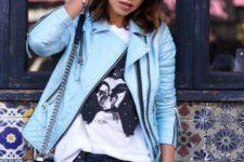 15 blue denim, a painted tee, a light blue leather jacket and a black bag