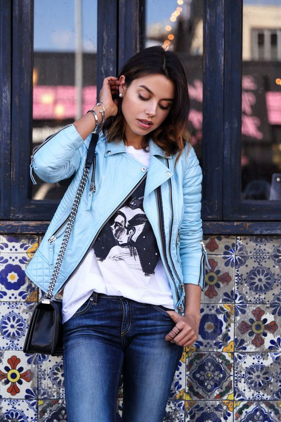 blue denim, a painted tee, a light blue leather jacket and a black bag