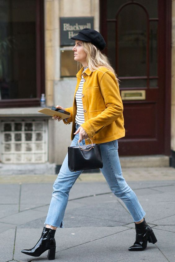 blue raw hem cropped jeans, a striped tee, black boots and a mustard jacket