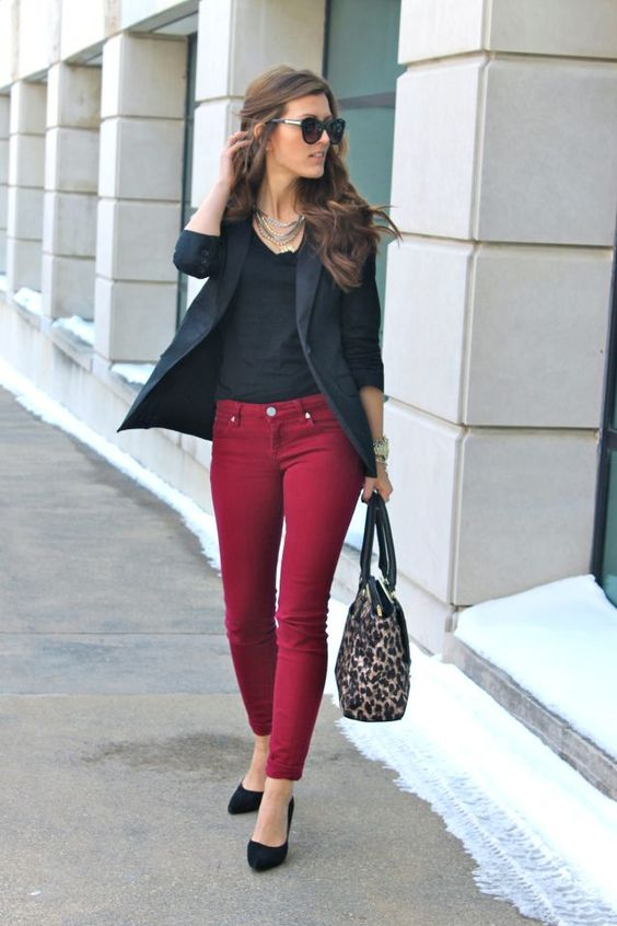 burgundy skinnies, a black top, a black blazer, black shoes and a leopard bag