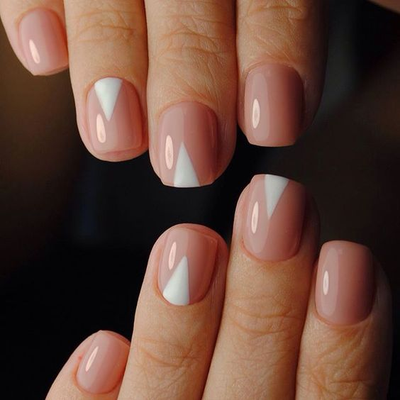 nude nails with white geometric touches for a bold and trendy modern look