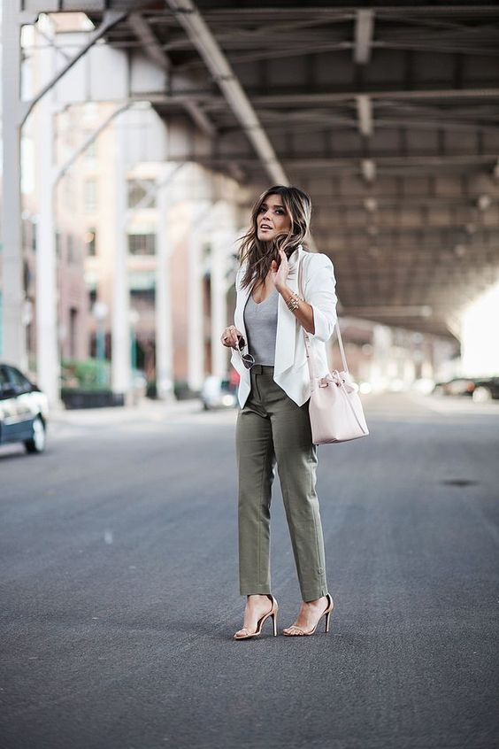 olive green pants, a grey top, a creamy blazer, a neutral bag and nude shoes