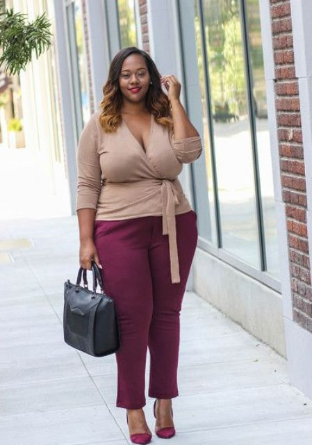 plum-colored pants, plum shoes, a taupe top and a black bag for a comfy outfit