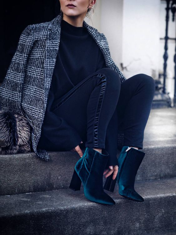 a grey tweed blazer, a black sweater, black jeans and emerald velvet booties