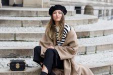 16 a striped tee, black culottes, a tan coat, black sock boots and a beret hat