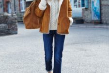 16 a white sweater, blue denim, an amber shearling coat, amber shoes and a white beanie