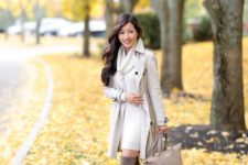 16 an off-white dress, an off-white trench, a neutral bag and tall suede brown boots