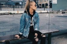 16 black ripped jeans, a black logo hoodie, a blue denim jacket and white sneakers