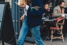 16 blue raw hem jeans, a navy embroidered bomber jacket, metallic shoes