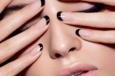 16 nude nails with a black tip are a stylish take on French mani and can be worn to work