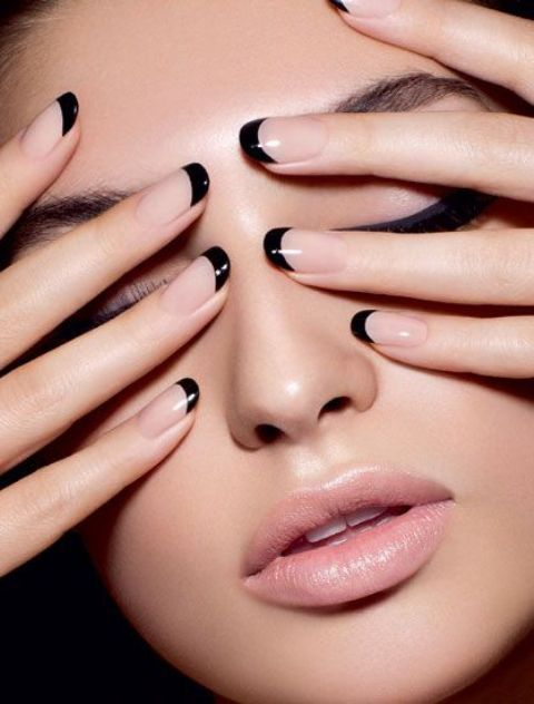 nude nails with a black tip are a stylish take on French mani and can be worn to work
